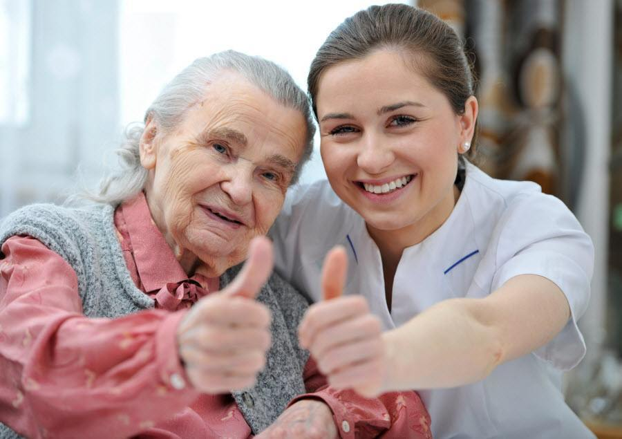 Old lady and carer giving thumbs up to respite care service in Bridlington