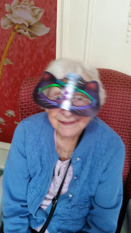 old lady dressed in kitten mask for Halloween party