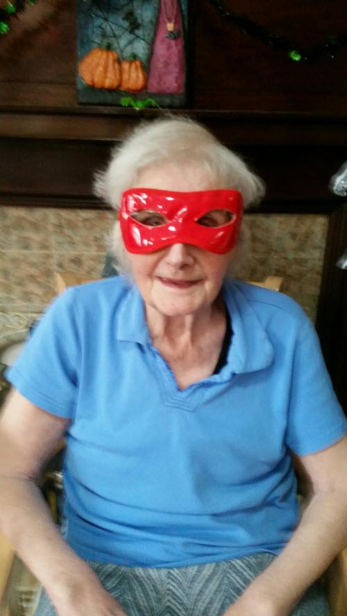 senior resident at Bridlington care home in red mask for Haloween